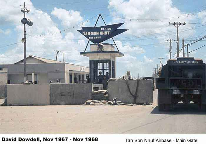 7. Tan Son Nhut AB, Main Gate with concrete barriors. Photo by: David Dowdell, LM 144, TSN, 377th SPS; DET 1/621st TCS/SP VT. 1967-1968.