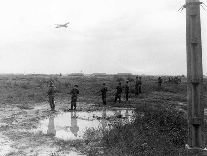 1. Photo above: 377th Security Police form a scrmish line to search for hiding sappers. 600th Photo Squadron, Vietnam.