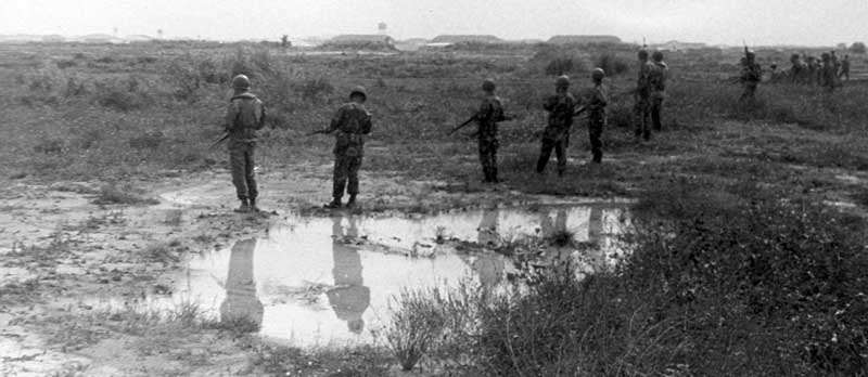 2. Close up: Photo above: 377th Security Police form a scrmish line to search for hiding sappers. 600th Photo Squadron, Vietnam.