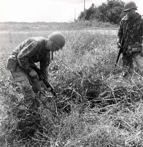 3. 377th APS Airmen search scrub brush and holes for VC and NVA sappers. 600th Photo Squadron, Vietnam.