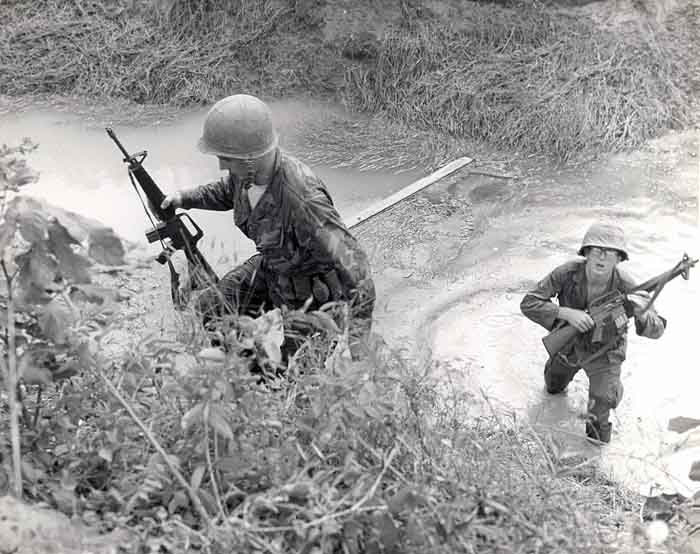 6. 377th APS Airmen crossing a gulley stream, searching for VC and NVA sappers. 600th Photo Squadron, Vietnam.