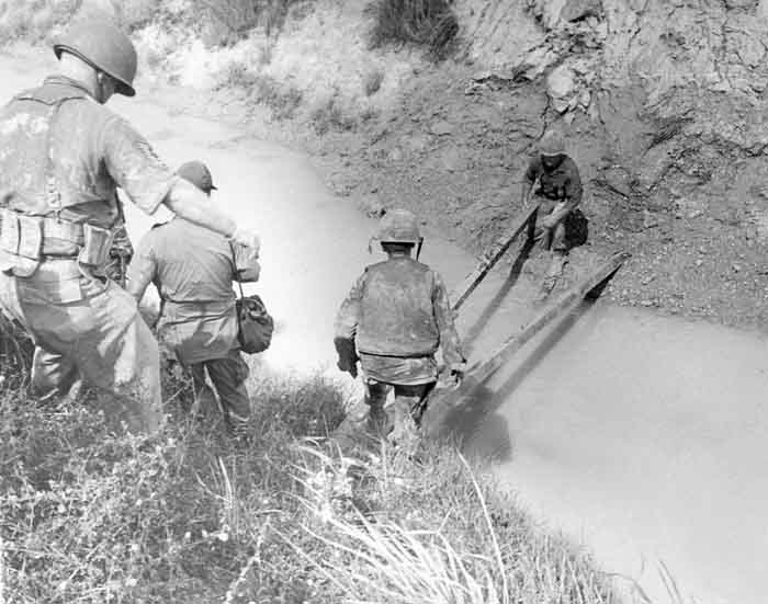 5. 377th APS Airmen crossing a gulley stream, searching for VC and NVA sappers. 600th Photo Squadron, Vietnam.