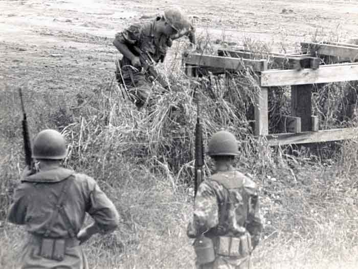 7. 377th APS Airmen search scrub brush, concealing-structures, and holes for VC and NVA sappers. 600th Photo Squadron, Vietnam.