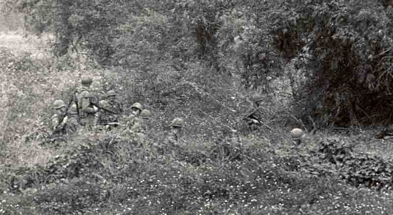 9. Close up below: 377th APS Airmen search perimeter fields, scrub brush, heavy foialage and forest for concealed VC and NVA sappers. 600th Photo Squadron, Vietnam.