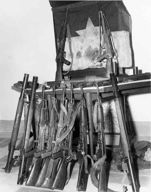 16. Photo right: VC/NVA weapons cache displayed. 600th Photo Squadron, Vietnam.