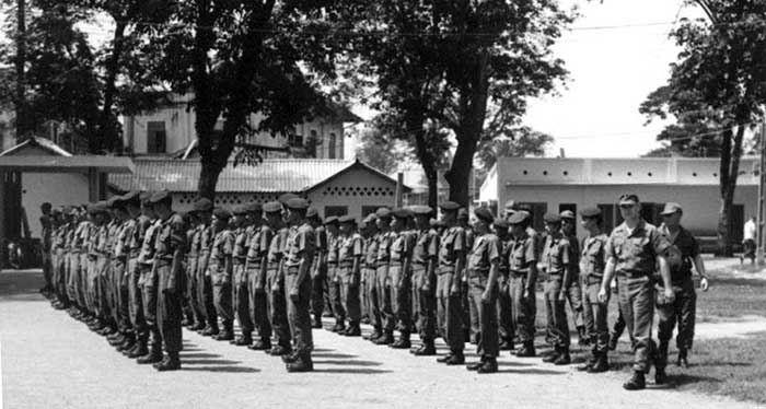1. USAF-Nungs Security Force, 1st Lt. James Duncan,6250th Air Police Sqdn.,inspecting the Nung Guards.Photo by Kailey Wong, 1967-1968.