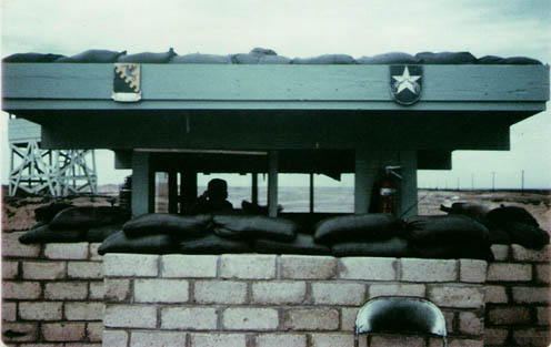 5. Tuy Hoa AB: Main Gate, south. Note tower, center-left. Photo by Sgt deWhite. 1969-1970.