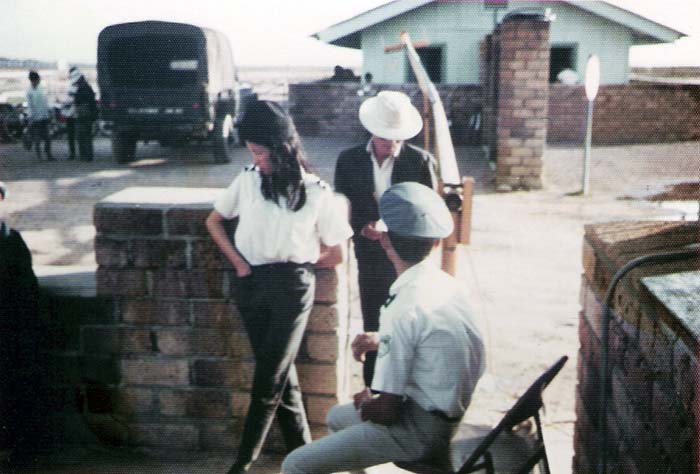 6. Tuy Hoa AB: Main Gate, south. ARVN QC checks Vietnamese workers. Photo by Sgt. deWhite. 1969-1970.
