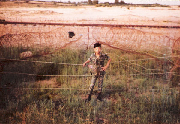 10. Tuy Hoa AB: Robin, Batman's sidekick, keeps eye on concertina wire. Photo by Sgt. deWhite. 1969-1970.