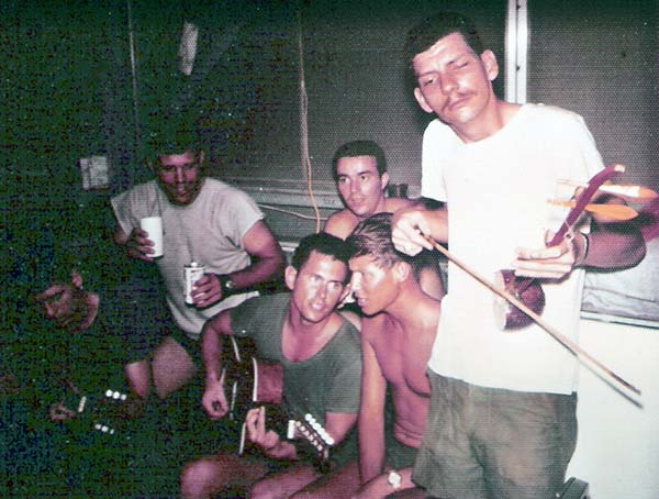 11. Tuy Hoa AB: Airman sing and clown around off duty. Photo by Sgt. deWhite. 1969-1970.