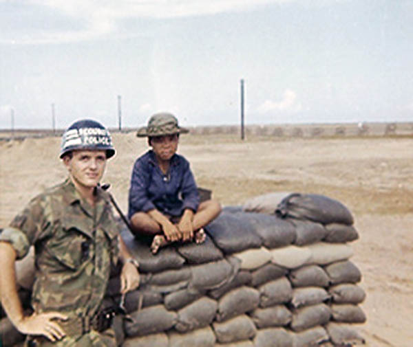 4. Tuy Hoa AB, Bunker. Henry, with visitor Vietnamese boy. Photo by: Henry Lesher, 1968-1969.