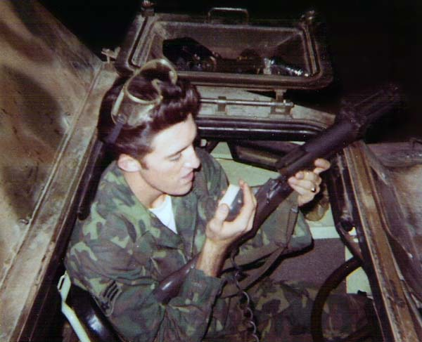 7. Ubon RTAFB. V100, Malcom Calhoun holding M-79 Grenade Launcher and talking on the radio mic. 1969-1970. Photo by: Malcom Calhoun II, UB, 8th SPS; TSN, 377th SPS; TUY, 31st SPS. 1969-1970.