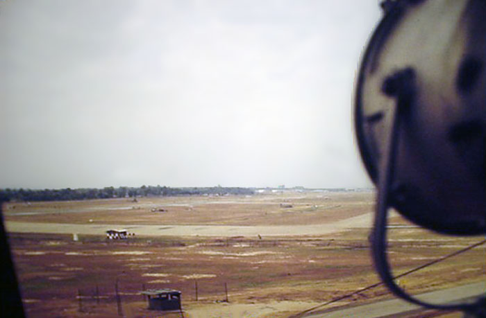 17. Ubon RTAFB. Runway and Taxiway as viewed from Tower, with searchlight. 1970-1971. Photo by: Richard Matott, LM 307, UB, 8th SPS K9. 1973-1974.