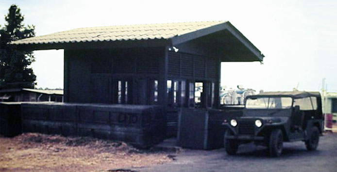 8. Ubon RTAFB. Gate and jeep. Photographer: Richard Matott, LM 307, UB, 8th SPS K9, 1973-1974.