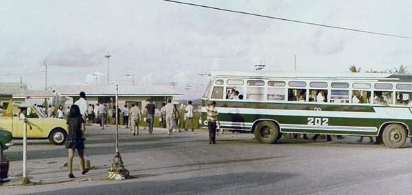 7. U-Tapao RTAFB, Main Gate: Baht Bus leaving the parking lot at U-Tapao main gate. Photo by: Roderick K. Duncan.