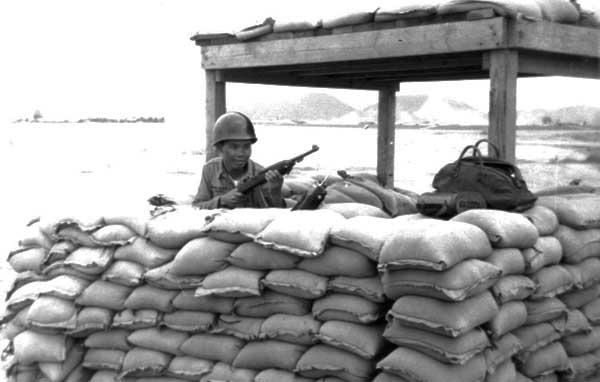 13. U-Tapao RTAFB, Bunker, Thai Guard. 1968. Photo by: William Bever, UT, 635th SPS, 1968.