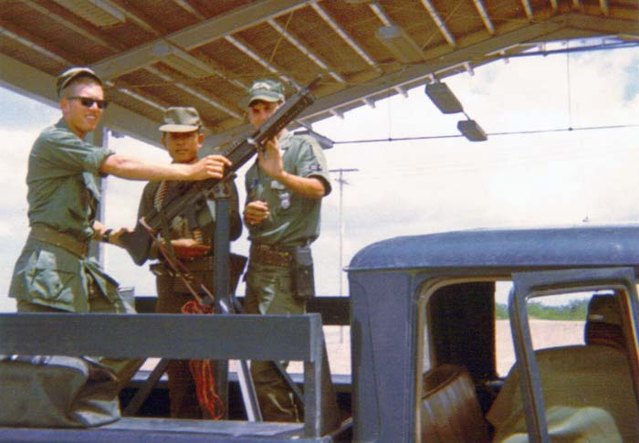 3. U-Tapao RTAFB, SAT truck with M60. 1968. Photo by: L/R: William Bever, Thai Guard, unknown Airman, 1968.