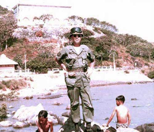 Vung Tau, Cap St. Jacques beach area with kids swimming and fishing. Madam Ky's home in background. MSgt Summerfield: 16